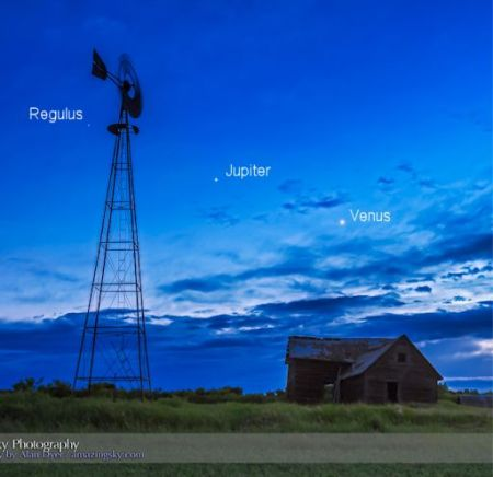 Venus (right) and Jupiter (centre), on June 12, 2015, as they are converging toward a close conjunction on June 30, 2015. The star Regulus is at left, left of the windmill. Photographed from an old farm yard north of Vulcan, Alberta. This is an HDR-stack of 3 exposures to record detail in the ground and sky. Shot with the Canon 60Da and 16-35mm lens.